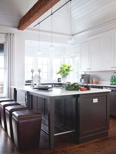 Painted dark brown lower cabinets, white upper