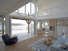 A sloping site with amazing coastal views in Cornwall. Painted Douglas Fir frame giving a light and airy feel throughout. Design by Roderick James Architects