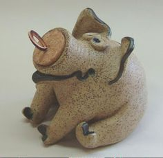 Individually hand-thrown and modeled in Iowa, this functional pottery bank is a sculptural delight. Ideally
