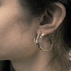 Pamela Love Exclusive Talon Earring (also <3 the double tragus piercings)