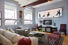Open Concept Loft - Living Room - Family Room - Upholstered Stools - Parsons Chairs - Media Console - Pendant Light Fixture - Asian Art - African American Art - Tribal art - Modern Art - Industrial Contemporary Loft - Hardwood Floors - Striped Rug