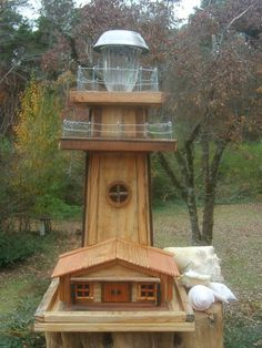 Solar Lighthouse Bird Feeder by TheMomandPopWoodshop on Etsy, $200.00