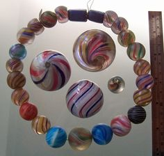 A strand of German Marble Beads. German marble bead production can be traced to the area around Lauscha and Haselbach in the state of Thuringen, Germany. Posted By Kathleen McCabe - Elsey.