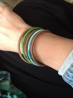 Bangles wrapped in embroidery thread. Use crazy glue to fasten thread to bracelet.