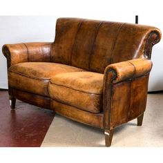 A vintage French distressed Art Deco leather sofa. A fine constructed worn leather settee in the deco taste with carved arms and tack decorated fronts. Vintage Leather Sofa, Best Leather Sofa, Leather Club Chairs, Cabin Furniture, Art Deco Furniture, Leather Furniture, Comfy Reading Chair, Comfy Sofa, Chesterfield