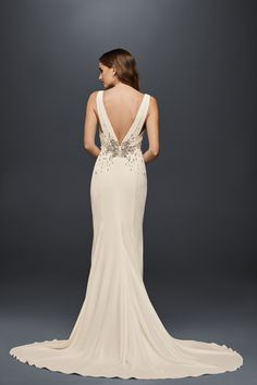 Jeweled Crepe V-Neckline Sheath Wedding Dress with Low Back featuring sunburst crystals | Shop this Wonder by Jenny Packham wedding dress at David's Bridal