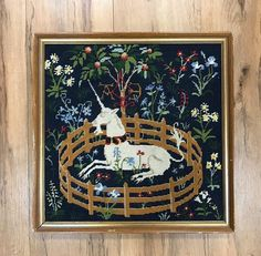 """From """"the Lady and the Unicorn"""" tapestry series, this fellow enchants with his needlepoint-perfect and gold-framed self. Mount him on your wall. Prop him on your shelf. Know that he is as watchful and whimsical as the Musée Cluny original! #TwigsofNWH #Unicorn #Needlepoint #ClunyMuseum #MuséeCluny #ThriftforPhilanthropy #NorthernWestchesterHospital"""