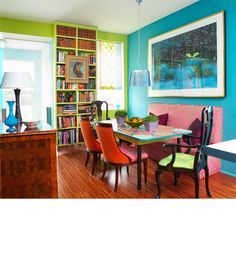 Holly Dyment Bright and bold dining room - so fun! Esp love the bookshelves, tabletop, and the burled walnut piece.