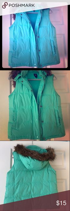 Gap puffer vest w faux fur trim hood like new Puffy blue green teal gap puffer vest no stains no signs of wear all zippers and buttons work. Very warm to throw over a longsleeved T-shirt has a detachable furry trimmed hood. Faux fur is brown. Size extra small but would fit a small size two size 4 maybe even a medium fleece lined pockets great for this winter really comfy and cozy. Worn three or so times. Smoke free home. Please make an offer GAP Jackets & Coats