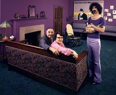 Frank Zappa in his Los Angeles home with his dad Francis, his mom Rosemarie, and his cat in 1970. Photograph by John Olson.