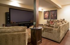 Post cover with a little table -   Cozy Home Theater - traditional - basement - chicago - Kristin Petro Interiors, Inc.