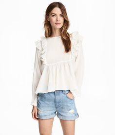 Check this out! Flared blouse in airy, woven viscose fabric. Opening and button at back of neck. Ruffles at top, seam at waist, and long sleeves with narrow, buttoned cuffs.  - Visit hm.com to see more.