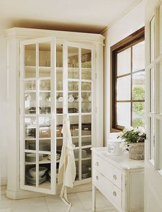 Cabinet- need this - glass doors or not - painted black or red with a black wax
