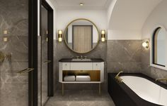 A elegant bathroom decor by Christian Liaigre, luxxury bathtub and the wall mirror with a gold decor, beautiful! Are you looking for unique bathtubs? Check out here: http://www.bocadolobo.com/en/partners-products/