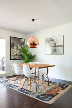 Dining table is Guthrie Stark by Jamie Lovell. A Tom Dixon Copper Pendant Light hangs over the table.