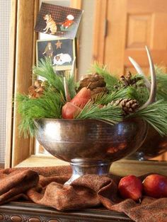 Top your Christmas table with a quick, easy and festive holiday centerpiece. Bountiful bowl    Fresh loose greens, large pinecones and red pears give a compote a natural look. Tuck in antlers for a rustic touch.