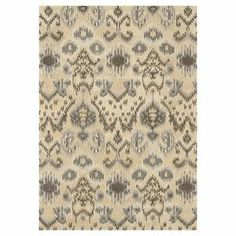 Hand-tufted wool rug with an ikat motif.   Product: RugConstruction Material: 100% WoolColor: Cream and greyFeatures:  Hand-hookedMade in India Note: Please be aware that actual colors may vary from those shown on your screen. Accent rugs may also not show the entire pattern that the corresponding area rugs have.Cleaning and Care: Clean spills immediately by blotting with a clean sponge or cloth. Vacuum regularly. Expect shedding. Professional cleaning recommended.  Rug pad recommended for…