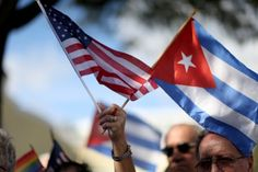 A protester holds an American flag and a Cuban one as she joins with others opposed to U. President Barack Obama& announcement earlier in the week of a change to the US Cuba policy at Jose Marti park on December 2014 in Miami, Florida Barack Obama, Cuban Flag, Washington, Little Havana, John Kerry, Berlin Wall, Foreign Policy, Tea Party, Hold On