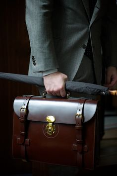 This is what separates the gentlemen from the peons. That briefcase must be a bitch for his peon to polish every morning.