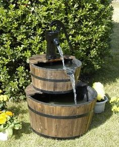 Bring the serenity and peace of running water to your home with the HGC 2 Tier Wood Barrel Outdoor Fountain . Simple and charming, this fountain. Large Outdoor Fountains, Outdoor Waterfall Fountain, Decorative Fountains, Barrel Fountain, Diy Water Fountain, Garden Water Fountains, Fountain Ideas, Garden Ponds, Backyard Ponds