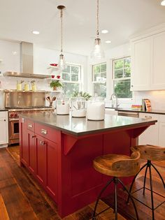 Two-tone kitchen paint color. Cabinets are painted white and island is painted in Benjamin Moore Caliente. #BenjaminMooreCaliente