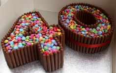 Number cake, Kit Kats or Cadbury Fingers around the edge, filled with Smarties or M&ms