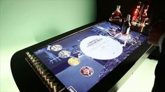 Multitouch table with object detection, detecting the bottles and use them as interface triggers. Owner: Martell. Agency: Cheil, interaction design and programming: TangibleDisplay, Devocité