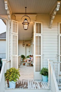 Timeless Style - New Orleans Cottage Revival - Southernliving. Louvered shutters, corbels, and wood ceilings and flooring lend a historic feel to the exterior.