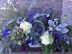 broody fall blues: iris, dahlias, kale, thistle, hydrangea, dusty miller, seeded eucalyptus, ferns, snow berries