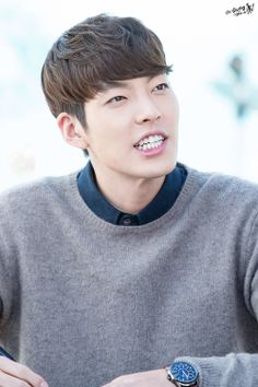 Kim Woo Bin~ Why take a pic when he's talking? He still looks handsome though!