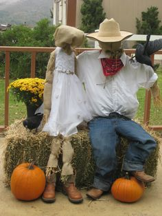 Fall wedding scarecrows with hay and pumpkins
