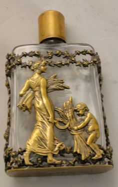 Art Nouveau perfume bottle, French, 1890. Small size, with silver gilt frame