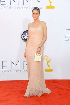 Emmys 2012: The Best of the Red Carpet - Amanda Peet is a lovely mix of minimal and pretty in a nude-hued gown by Calvin Klein.