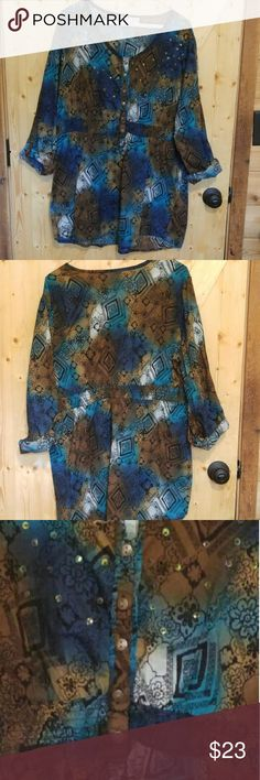 Women's Fashion Blouse Pictures does not do this blouse Justice. You cannot see the beautiful array of colors like you can up close. It has decorative Western iron button down the front with an elastic waist. It is 31 inches long, 42 inches bust comma size 18/20 Tops Blouses