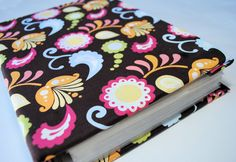 Fabric Covered Notebook or Binder Tutorial. Would be great to put over a cheap photo album book to make it look trendy!