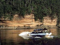 Take an eight and a half mile adventure in the Wisconsin Dells aboard a duck! The unique amphibious vehicle drives you on land to the Dells then splashes in as a boat. This unique tour should not be missed! Wisconsin Dells Ducks, Wisconsin Dells Attractions, Wisconsin River, Vacation Destinations, Vacation Spots, Vacation Ideas, Duck Tour, Amphibious Vehicle, Attraction Tickets