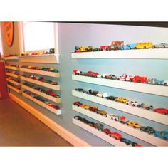 Toy car storage for little boys; would the cars actually stay on there or would they still be all over the living room?