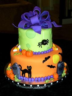Did this cake for a neighbor, whos daughter was having a Halloween themed birthday party.  This is the first cake Ive done in months, it was fun working on it!  8 and 5 round, all fondant w/ fondant accents.