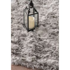 Soft and plush, the pile on this contemporary area rug is made from polyester to prevent shedding, and makes a fun addition to any fashionable space.  Add a sense of texture to a modern living room with this attractive shag rug.