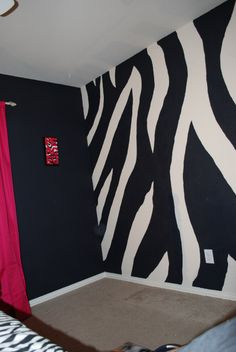 black accent wall?  made with chalkboard paint maybe?