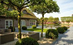 Compact Serenity: Antwerp Pond Garden by Jacques van Leuken