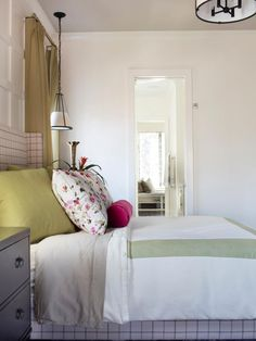 A star of HGTV Smart Home 2016, the master bedroom showcases a combination of chic modern design and pops of pink. From the experts at HGTV.com.