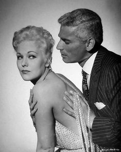 Kim Novak with Jeff Chandler in a publicity photo for Jeanne Eagels (1957)