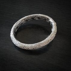 This eternal bangle in stunning white diamonds loop to adorn her wrists #AaryaJewelry   #Forever #Eternal #Love #LoveDiamonds #DiamondJewelry #GoldJewelry #Bespoke #18k #Gold #Diamond #DiamondBangle #GoldBangle #Luxury #LuxuryJewelry #Jewellery #Sparkles #ForHer #Gift #ForYou #EternalLove #WhiteGold #DiamondsAreForever #Present #WristGame #luxuryfashion #Eveningwear #JustForHer #instajewelry