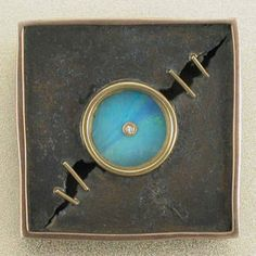 This brooch by Andy Cooperman is mine :-)  Image from http://www.patina-gallery.com/exhibits/past_exhib/05cooperman/c_images/0075pin.jpg.