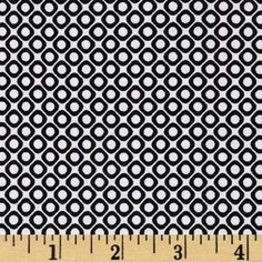 Designed by Lisa Tilse for Robert Kaufman, this cotton fabric is perfect for quilting, apparel and home decor accents. Colors include black and white.