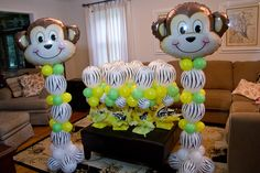 Safari theme baby shower.  Monkey columns (6 ft) and zebra topiaries.  Decor by Balloon Brigade.