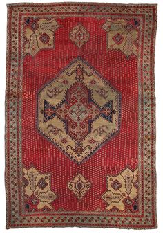 Caucasian Ushak rug, burgundy ground with a large medallion Ushak pattern and small stylized flowers