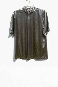A shiny top such as this was appropriate for use in discotheques and dance halls, however many people also chose to wear these in their places of education.   19 Relics From The '90s Hologram Epidemic