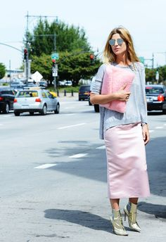 Street Style - Classy pink midi pencil skirt with grey cashmere sweater. The metallic boots and fur clutch give the outfit an edginess. <3